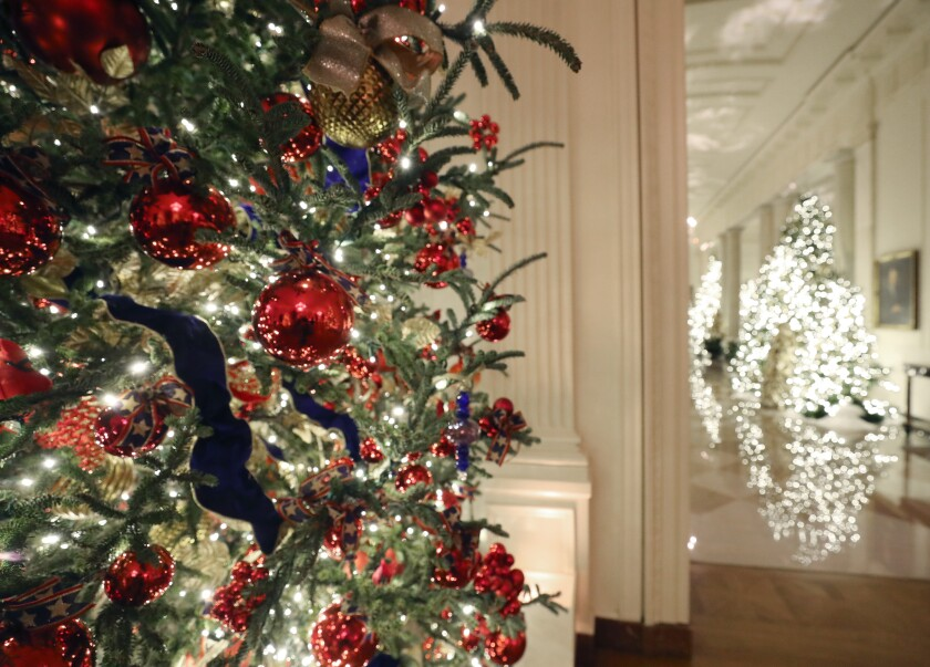 Christmas decorations are displayed Monday in the East Room of the White House.