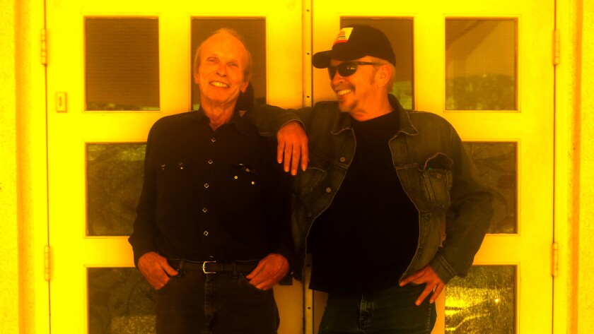 """Siblings Phil, left, and Dave Alvin in downtown Downey on Aug. 31, 2015. The brothers' new album, """"Lost Time,"""" further explores the blues and R&B influences that inspired the Downey residents as kids before they grew up and formed the roots-rock band the Blasters."""