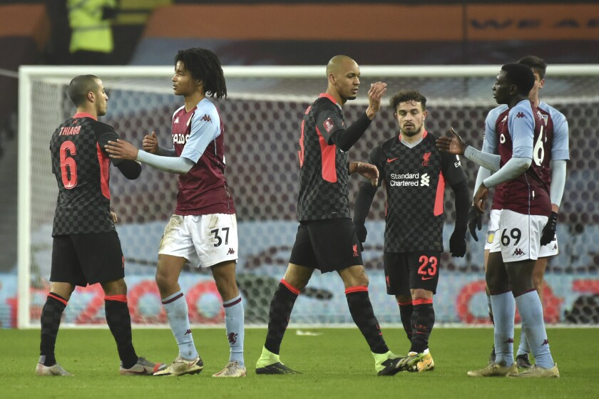 Players shake hands after the FA Cup 3rd round soccer match between Aston Villa and Liverpool at Villa Park stadium in Birmingham, England, Friday, Jan. 8, 2021. (AP Photo/Rui Vieira)