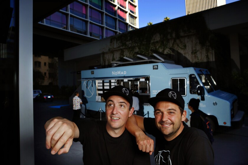 Chef Daniel Humm (right) and Will Guidara (left), co-owners of the Nomad food truck, are photographed near the truck outside of the Line Hotel in Koreatown.