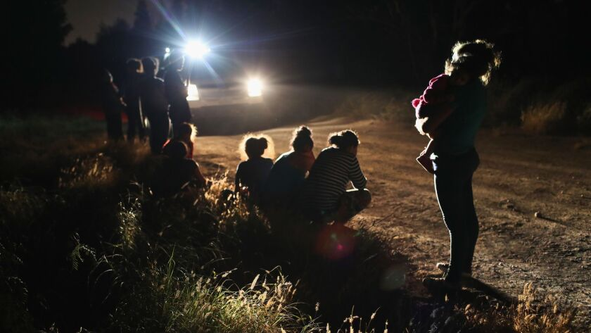 U.S. Border Patrol agents arrive to detain Central American asylum seekers near the U.S.-Mexico border in McAllen, Texas.