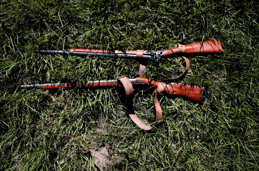 Period rifles and other artifacts were used in the reenactment.