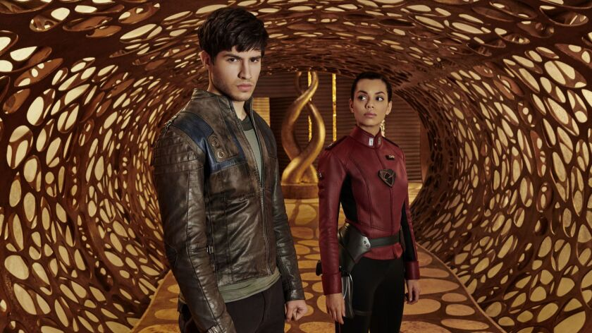 "Seg-El (Cameron Cuffe) and Lyta-Zod (Georgina Campbell) in Syfy's ""Krypton."""
