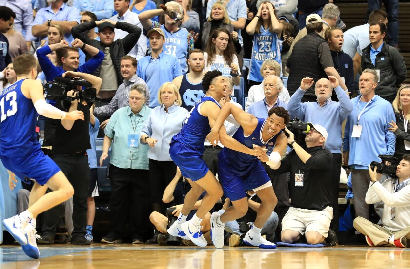 Duke's Wendell Moore, right, and teammate Jordan Goldwire react after Moore's winning basket Feb. 8, 2020.