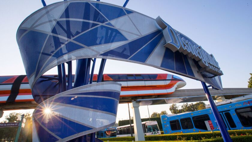 The Disneyland Monorail passes by the Disneyland entrance sign at the East Shuttle Area and South Harbor Boulevard in Anaheim in 2017.