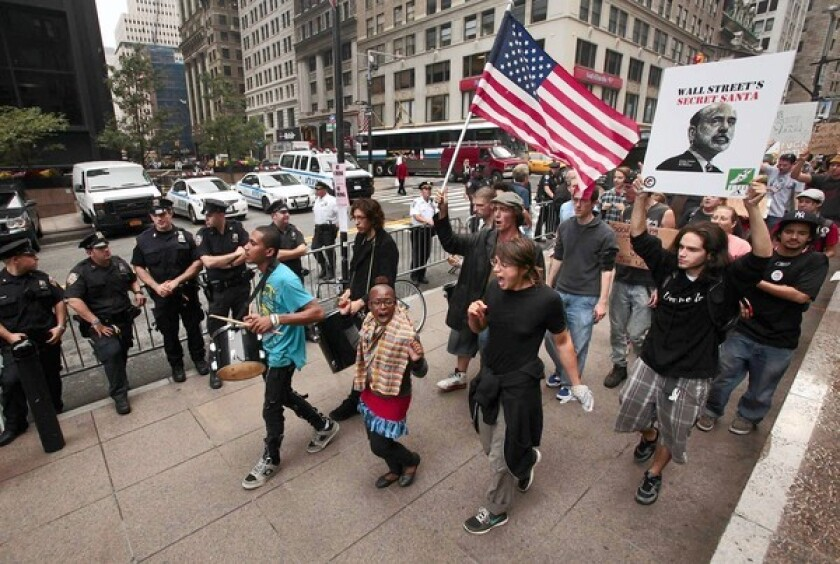 Day 13 of Occupy Wall Street begins with a march through the streets of Lower Manhattan around the time the opening bell rings on the stock exchange.