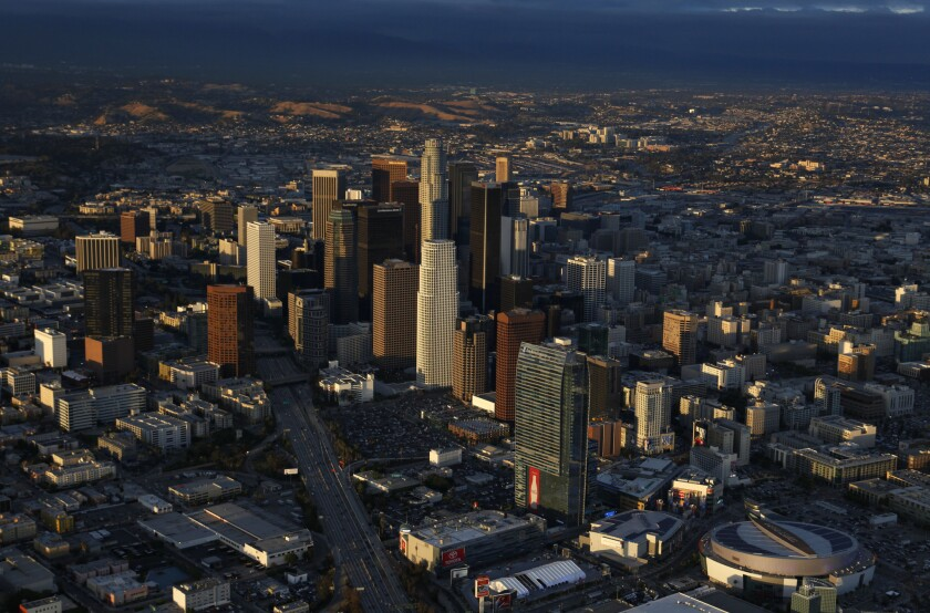 The four leading mayoral candidates -- Eric Garcetti, Wendy Greuel, Kevin James and Jan Perry -- agree that Los Angeles is and will continue to be defined by the distinctiveness of its neighborhoods. Above: An aerial view of downtown Los Angeles in 2010.