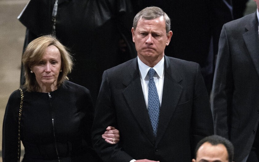 Supreme Court Chief Justice John Roberts and his wife Jane Sullivan Roberts depart the funeral for the late Supreme Court justice Antonin Scalia in Washington, D.C. on Feb. 20.