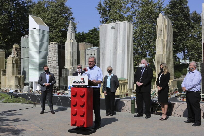 San Diego County Supervisor Jim Desmond speaks at Legolands' Miniland.