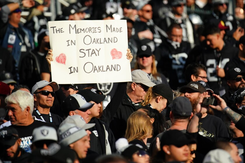 A fan holds up a sign during the second half of a the Raiders' final home game in Oakland on Dec. 15.