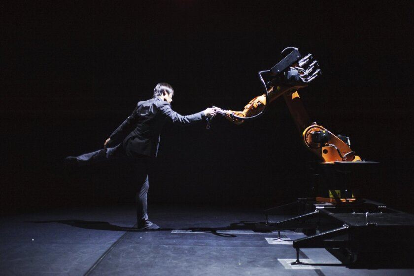 In 'Huang Yi and KUKA' Yi dances a duet with a robotic arm 8 p.m. Wednesday, Oct. 14 at Mandeville Auditorium, UCSD campus.