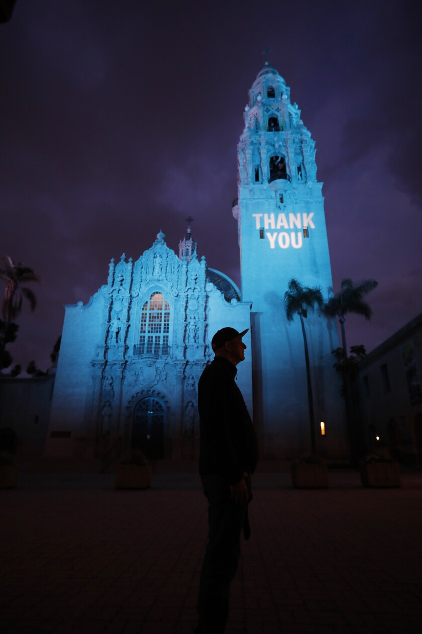 Micah Parzen, CEO of the Museum of Man, stands near The California Tower
