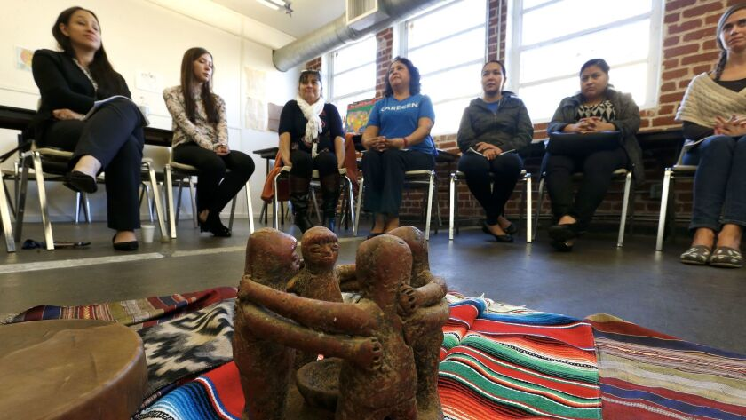 A circle of friends ceramic piece from Peru is placed inside a reflection and healing circle during