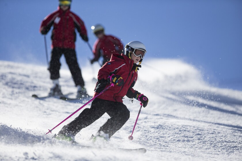 Young skiers from the Snow Summit Development Team follow each other down the slopes at Snow Summit on Dec. 4 in Big Bear Lake, Calif.