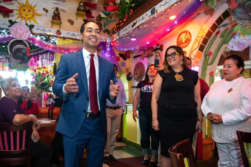 Presidential candidate Julian Castro talks with patrons at La Parrilla Restaurant