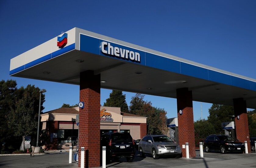 A Chevron station in Greenbrae, Calif. The company contributed $1.8 million to oil industry lobbying efforts to block climate change legislation.