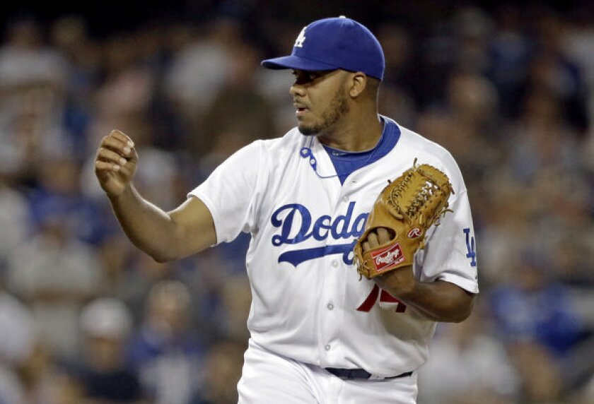 Kenley Jansen, named the Dodgers' closer Tuesday, pumps his fist after getting the final out against the Washington Nationals in May.