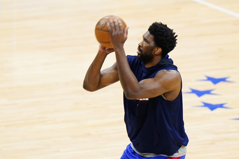 Philadelphia 76ers' Joel Embiid warms up before Game 1 of a second-round NBA basketball playoff series against the Atlanta Hawks, Sunday, June 6, 2021, in Philadelphia. (AP Photo/Matt Slocum)
