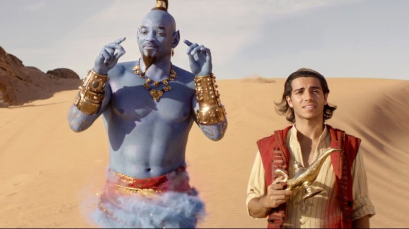 "Will Smith as the Genie, with Mena Massoud as Aladdin, in Disney's live-action reboot of ""Aladdin."""