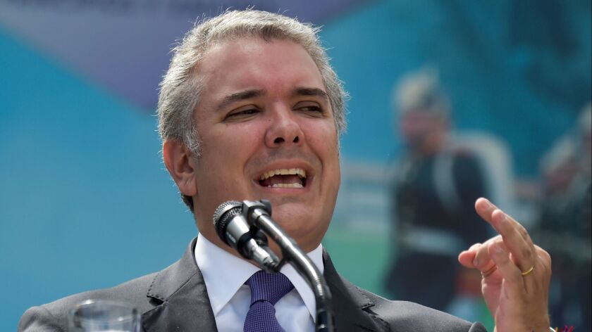 Colombian President Ivan Duque has criticized the peace accord his predecessor forged with FARC rebels as too generous.