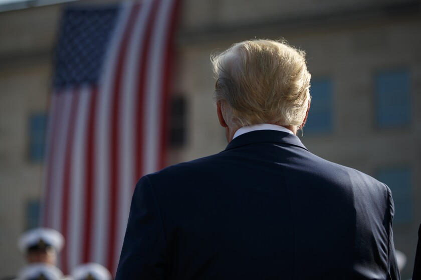 President Trump stands for the national anthem during a ceremony honoring the victims of Sept. 11.