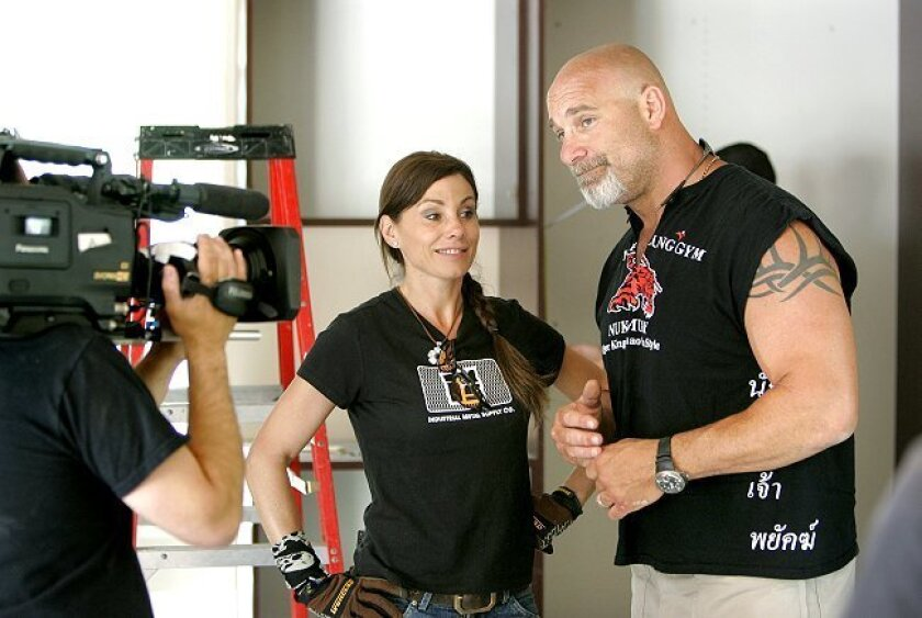 """Bill Goldberg and his wife Wanda are videotaped in the garage of his Bonsall home during its makeover for the TV show """"Garage Mahal"""" that Goldberg hosts on the DIY Network."""