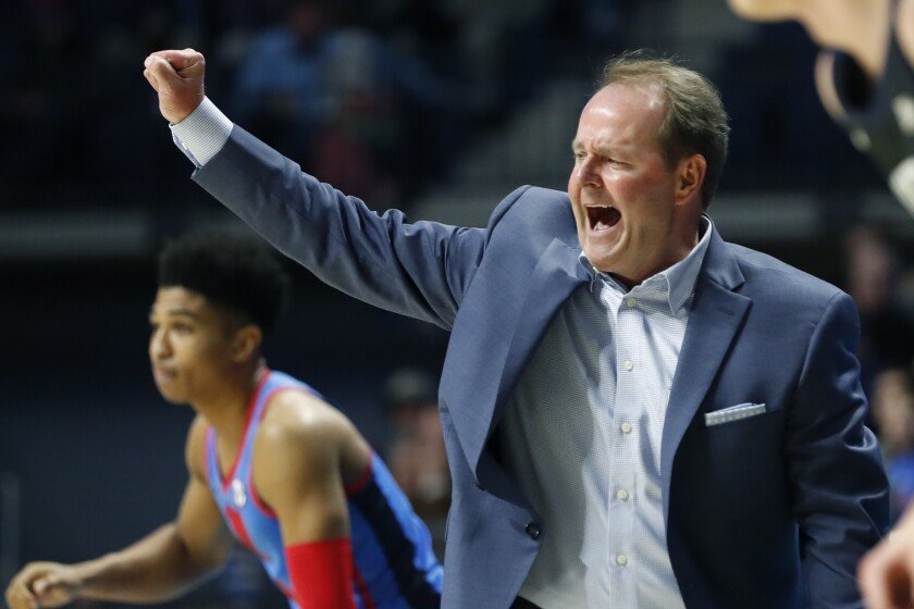 FILE - In this Dec. 3, 2019, file photo, Mississippi coach Kermit Davis gestures to his players during the second half of an NCAA college basketball game against Butler in Oxford, Miss. Davis took Mississippi back to the NCAA Tournament in his first season two years ago. He's banking heavily on transfers for any chance to make another run. The Rebels, who must replace high-scoring guard Breein Tyree, brought in three Division I transfers to bolster a roster led by starting guard Devontae Shuler. (AP Photo/Rogelio V. Solis, File)
