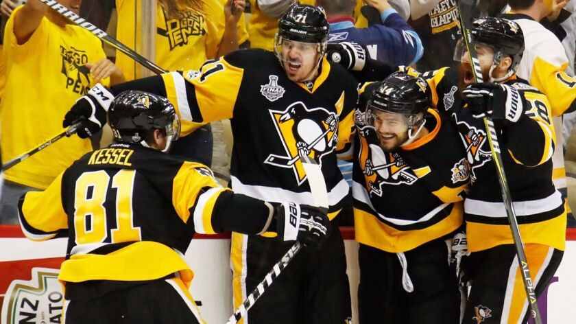 Pittsburgh Penguins' Evgeni Malkin (71) celebrates with teammates after scoring a goal during the third period in Game 2 of the Stanley Cup Final against the Nashville Predators, Wednesday.