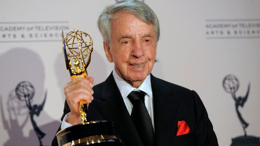 Norman Brokaw poses with the Governor's Award in the press room at the Creative Arts Emmy Awards in Los Angeles on Aug. 21, 2010.