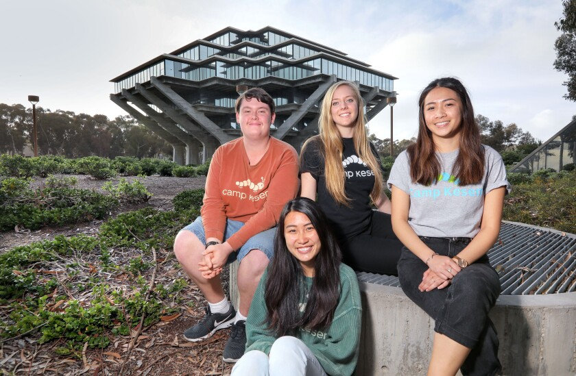Campus coordinators for Camp Kesem, photographed last week near UC San Diego's Geisel library, are, left to right, San Diego State chapter co-founder Tyler Leptich, and UCSD coordinators Sarah Gan, foreground, Tiffany Mora and Krystine Bernas.