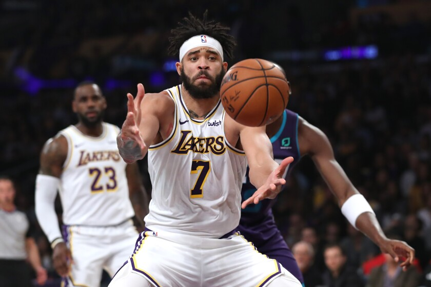 Lakers center JaVale McGee reaches for a rebound during a game against the Hornets on Oct. 27.