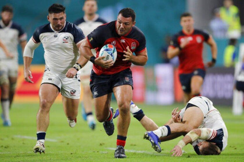 England's Ellis Genge runs during the Rugby World Cup Pool C game at Kobe Misaki Stadium against the United States in Kobe, Japan, Thursday, Sept. 26, 2019. (AP Photo/Christophe Ena)