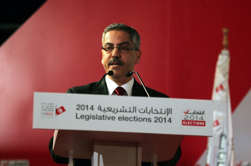 Chafik Sarsar, president of the Tunisian election commission, speaks at an Oct. 30 news conference in Tunis announcing the preliminary results of recent legislative elections.