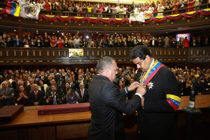 Venezuelan National Assembly President Diosdado Cabello puts the presidential sash on Vice President Nicolas Maduro, Hugo Chavez's handpicked successor. Maduro was sworn in as acting president in Caracas just hours after Chavez's funeral.