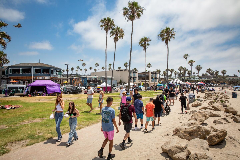 People go for a seaside stroll off Abbott Street in Ocean Beach.