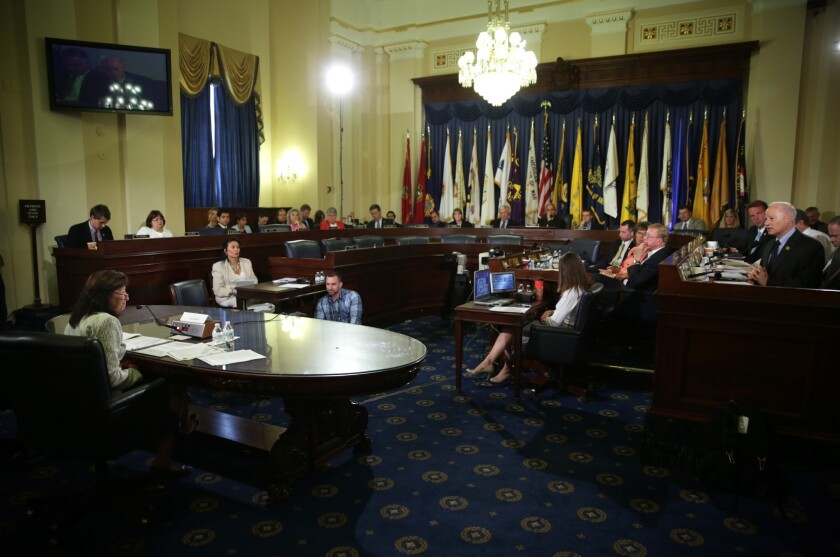 Gina Farrisee, the VA's assistant secretary for human resources and administration, testifies during a hearing on bonuses Friday before the House Veterans' Affairs Committee.
