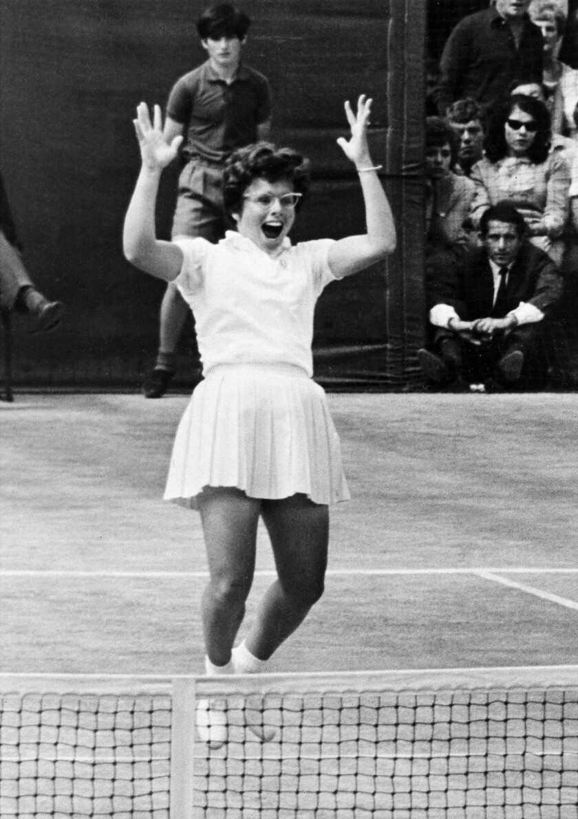 Billie Jean King leaps for joy after her winning shot to clinch the Wimbledon singles title in London, July 2, 1966.