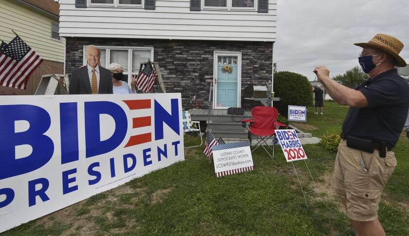 Armonde Casagrande takes a photo of Mary Boylan in front of a Joe Biden cutout in Luzerne County, Pennsylvania.