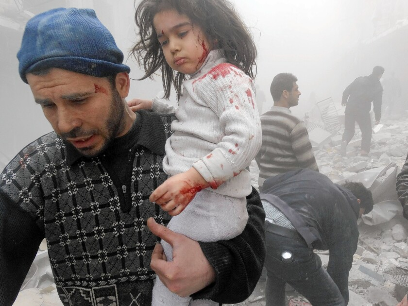 """A Syrian man evacuates a child found after government forces dropped a barrel bomb in Aleppo. The Obama administration ordered Syria to close its embassy in Washington """"in consideration of the atrocities the Assad regime has committed against the Syrian people."""""""