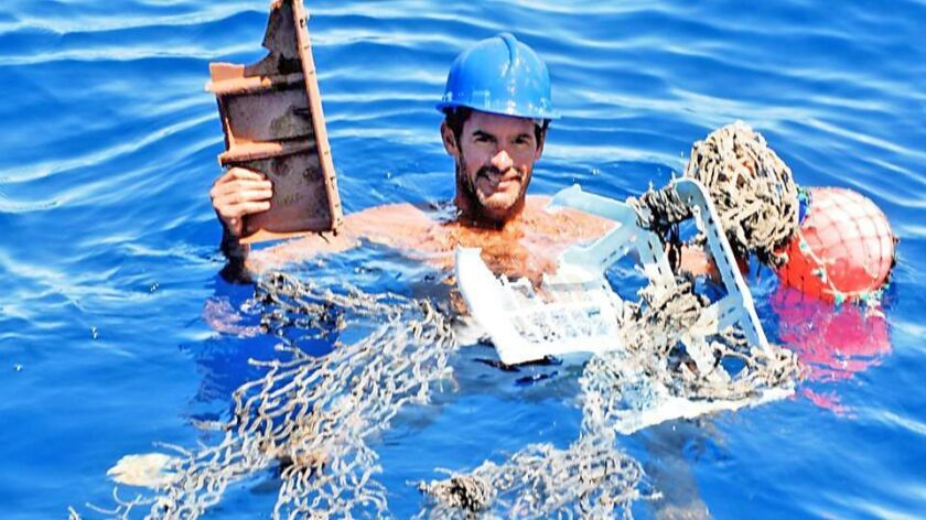 Laguna Beach native James Pribam holds plastic trash he found 2,000 miles out to sea between Brazil and South Africa in the South Atlantic Gyre in 2011.