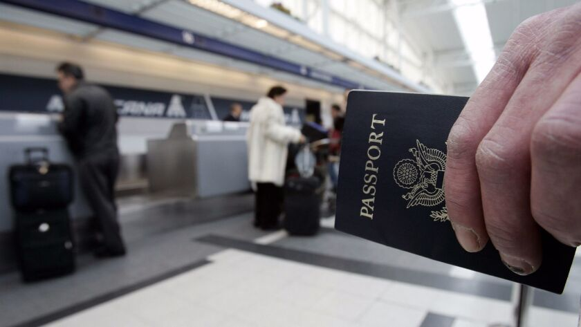 A passenger waits in line with his passport.