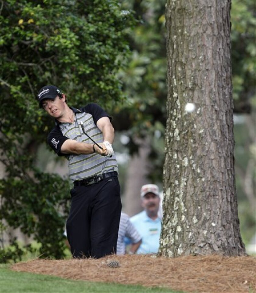 Rory McIlroy of Northern Ireland hits his ball out from next to a cabin during the final round of the Masters golf tournament Sunday, April 10, 2011, in Augusta, Ga. McIlroy was playing the 10th hole. (AP Photo/Dave Martin)