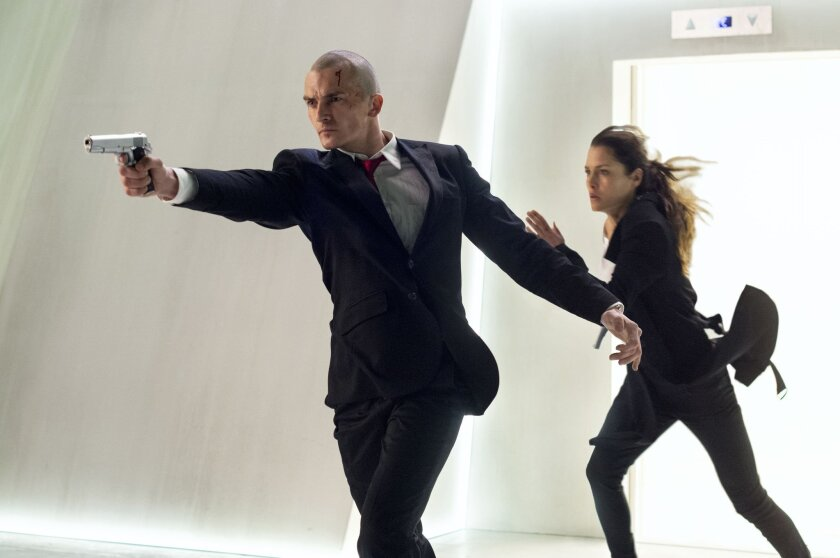 "In this image released by Twentieth Century Fox, Rupert Friend, left, and Hannah Ware appear in a scene from, ""Hitman: Agent 47."" (Reiner Bajo/Twentieth Century Fox via AP)"