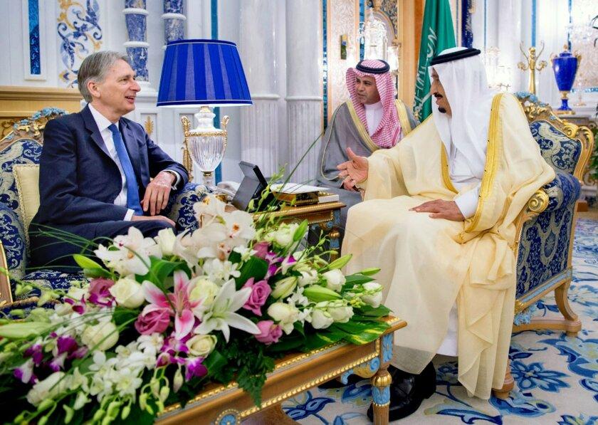 In this Sunday May 29, 2016 photo released by the Saudi Press Agency, SPA, King Salman bin Abdulaziz Al Saud, right, receives British Foreign Secretary Philip Hammond in Jiddah, Saudi Arabia. (Saudi Press Agency via AP)
