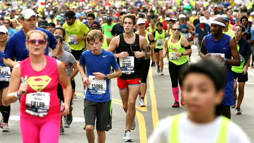 Runners pass through downtown Los Angeles during the 2014 L.A. Marathon.