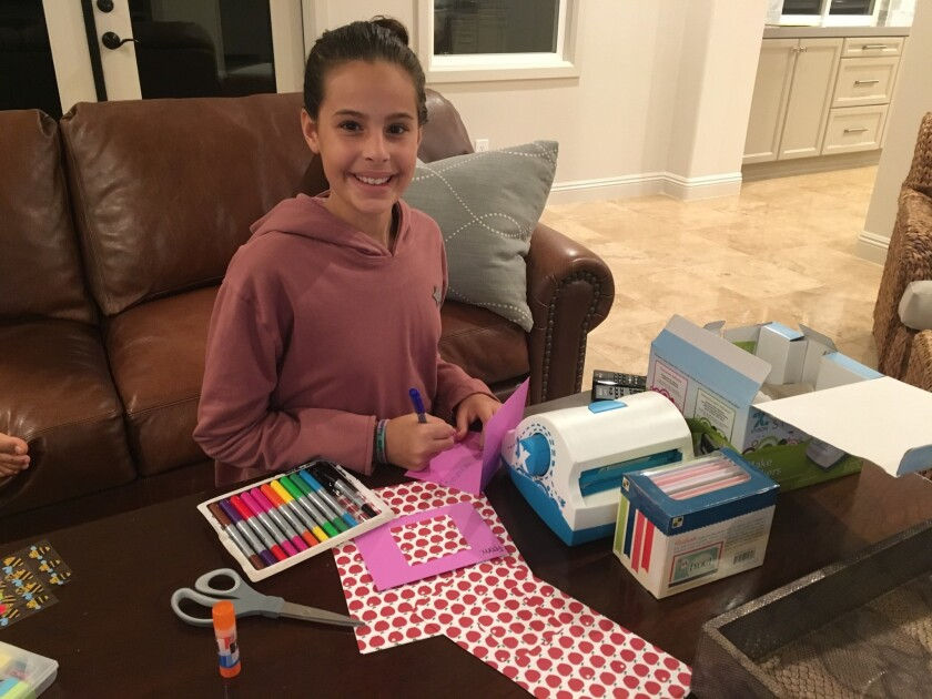 Bella Silberstein works on Rosh Hashanah cards she is selling as a fundraiser for Lev Lalev, an Israeli orphanage.