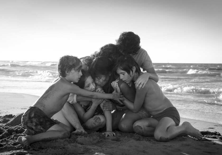 """This image released by Netflix shows Yalitza Aparicio, center, in a scene from the film """"Roma,"""" by f"""