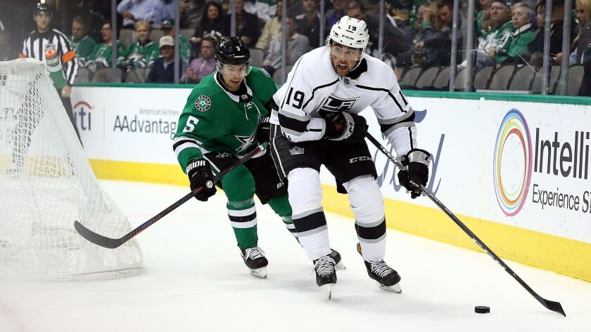 Kings' Alex Iafallo (19) skates the puck against Dallas Stars' Connor Carrick (5) in the second period at American Airlines Center on Tuesday in Dallas.