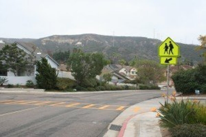 The intersection of Worsch Drive and Carmel Park Drive at Santa Nella Place is considered an unsafe pedestrian crossing and residents hope to get a stop sign installed.