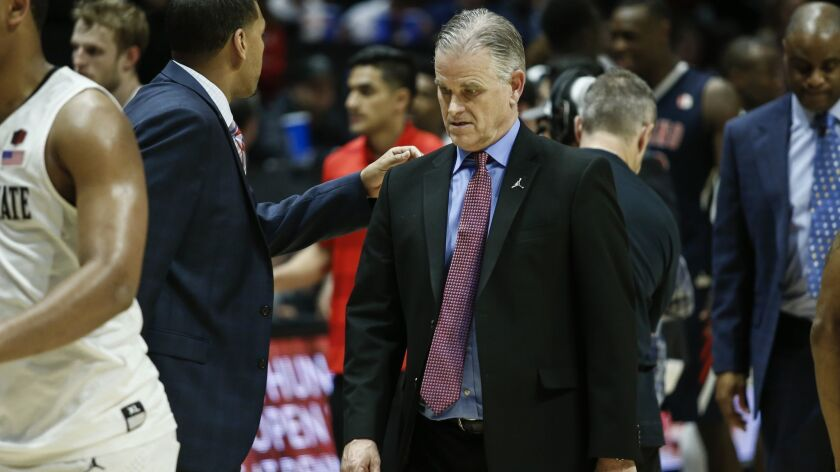 SDSU head coach Brian Dutcher walks off the court after the Aztecs loss to Fresno State.